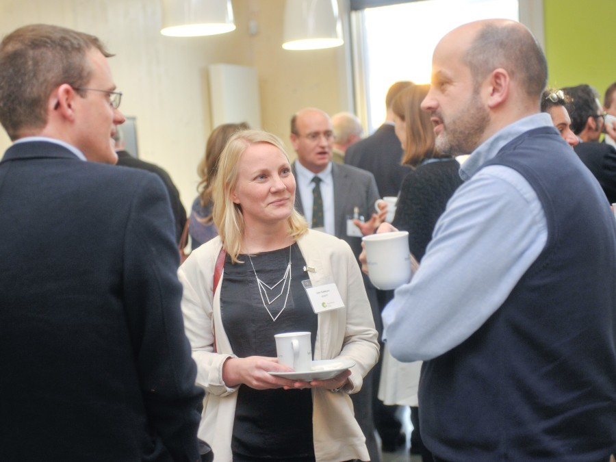 Discussing the conference during the coffee break at REAP 2014