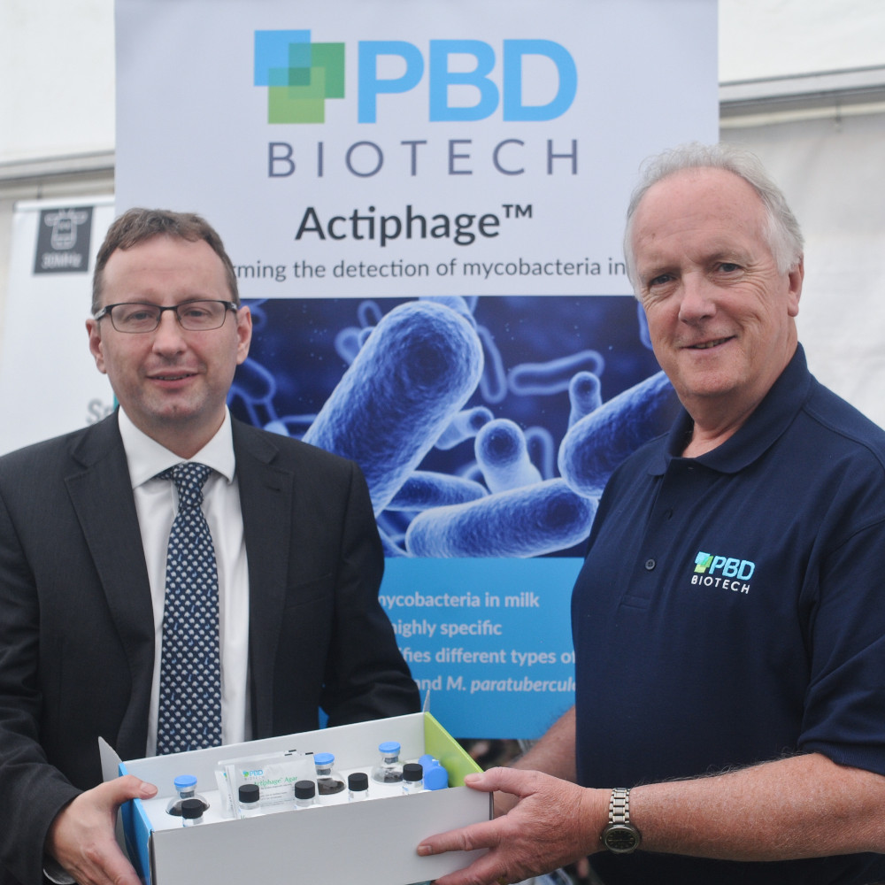 Chris Starkie, Chief Executive of New Anglia LEP, is shown Actiphage by Berwyn Clarke of PBD Biotech
