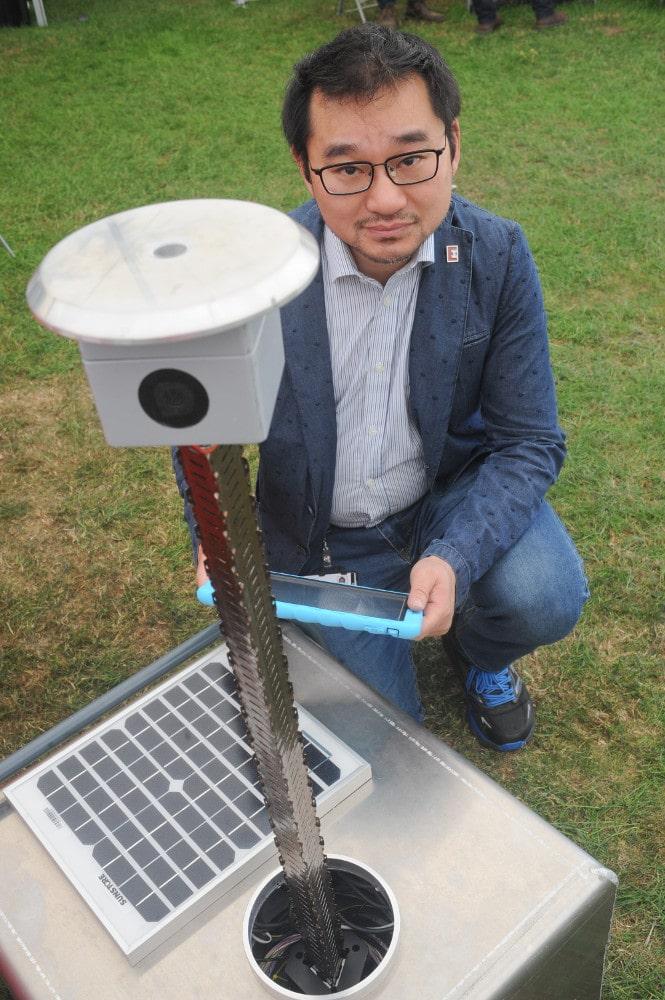 Ji Zhou with Earlham Institute's CropQuant robot