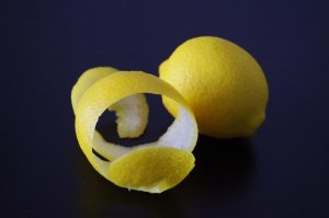 whole lemon and lemon peel waste