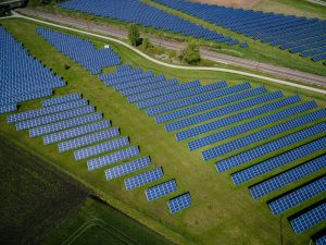 aerial view of solar panels in a field