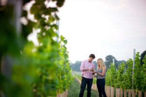 Ben & Hannah Witchell in the vines - credit Flint Vineyard